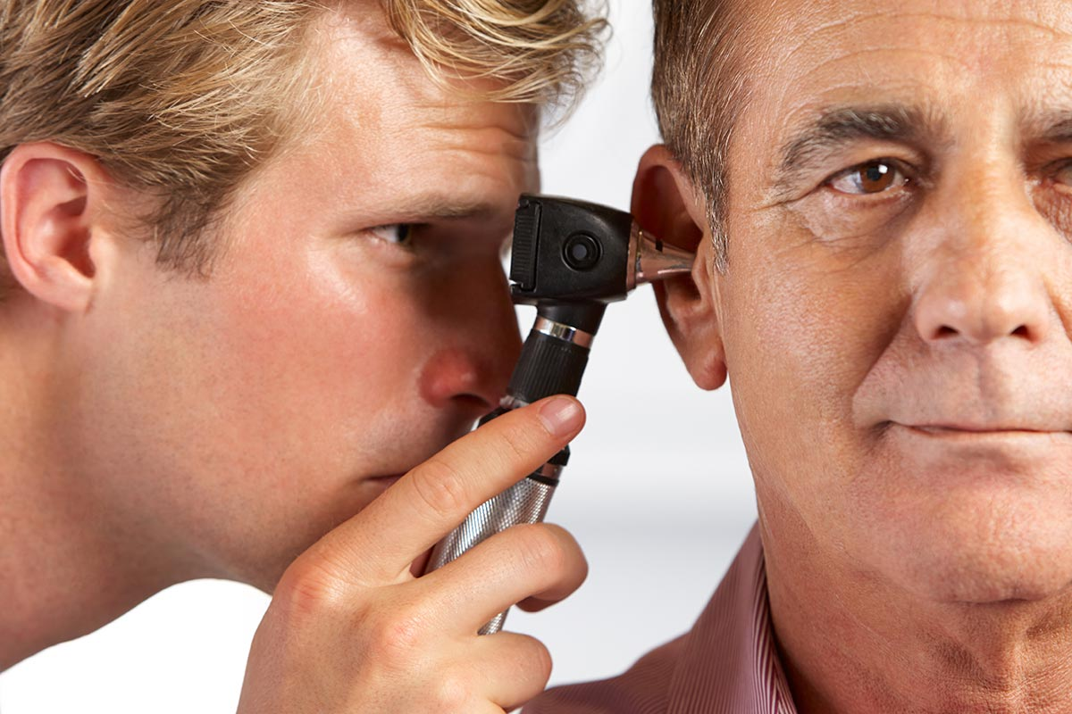 man getting ears checked